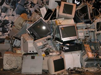 Photo, colours, a pile of old computers, monitors and e-waste
