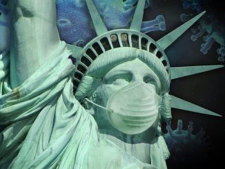 The virus of the pandemia that comes from China is on the background of the Statue of Liberty wearing a protective mask.