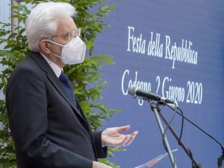 "The picture shows Italian president Sergio Mattarella giving a speech in Codogno ( epicentre of the Covid-19 epidemy in Italy) on June 2nd. The president (in three-quarter profile) wears a dark blue jacket, a white shirt, a blue tie and the face mask. Behind the speaker and the microphone there are some palnts and a blue backdrop whit the white writing ""Festa della Repubblica. Codogno 2 Giugno 2020"" on it"