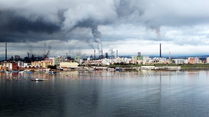 urban panorama with buildings and establishments, from whose chimneys smoke comes out