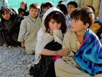 Economy after covid, picture of children sitting on the ground in a poor area of the world