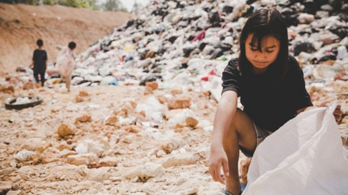 World hunger: permanent emergencies, asian girl scattering in a dumpsite