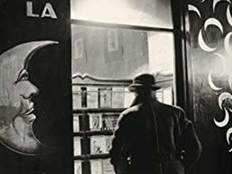 Paris literature, vintage picture, black and white, man from behind in front of a shop window