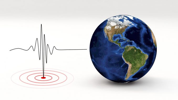 in this coloured photo you can see, on the right, a globe, and on the left, a stock chart like an electrocardiogram