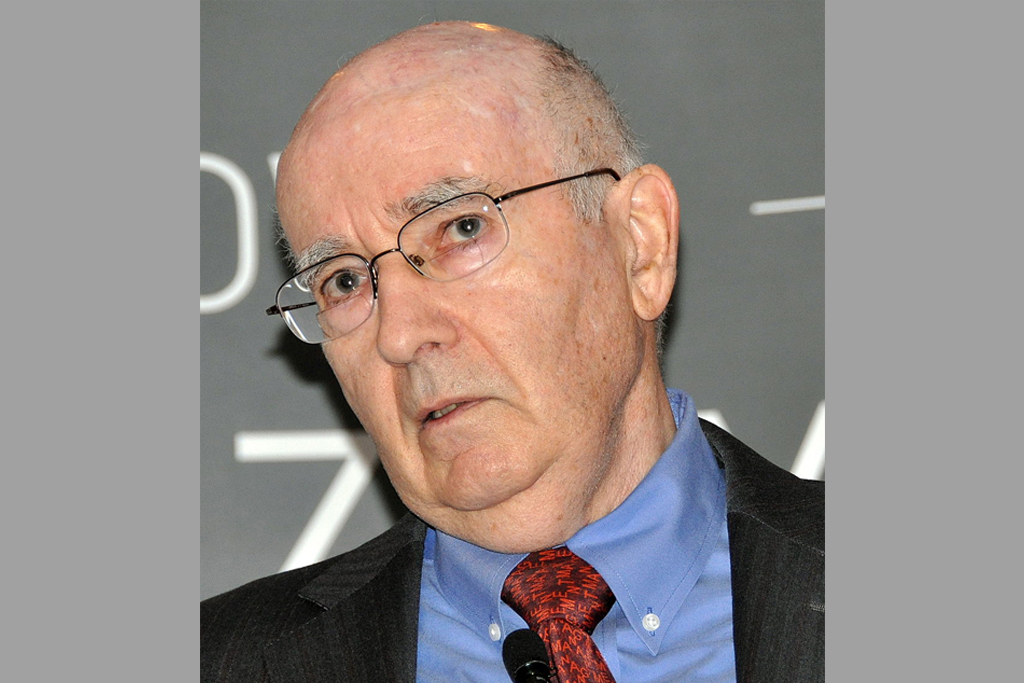 you can see Philip Kotler, a famous university teacher of marketing. He wears a red tie and a blu shirt.