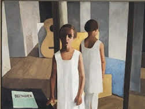 nella foto a colori si vede un bambino vestito con una tunica bianca; alla sua sinistra c'è un tavolo con un giornale e la scritta Beethoven; sullo sfondo, una chitarra