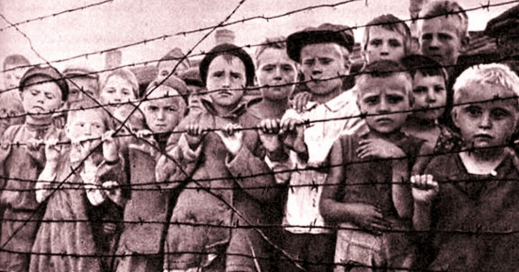 in the black and white image you can see children locked up in a Nazi concentration camp, leaning on a barbed wire