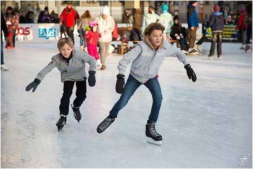in the color photo you can see two boys ice skating