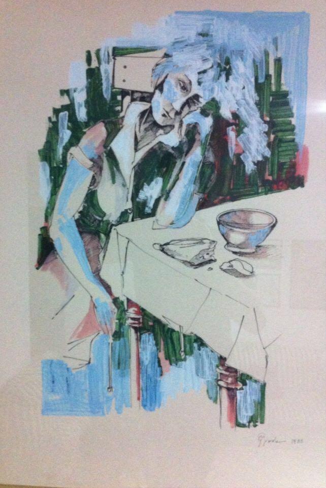 la foto a colori mostra un dipinto a penna e acrilico con una donna naziana che poggia il braccio sul tavolo; la mano del braccio si posa anche sulla guancia; sul tavolo è presente una brocca
