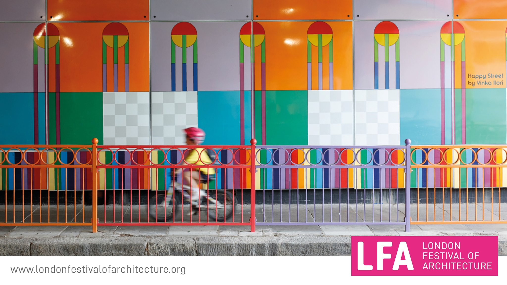 London Festival of Architecture, the poster: a colorful wall, a boardwalk with a baby boy on a bicycle, a colorful protective railing