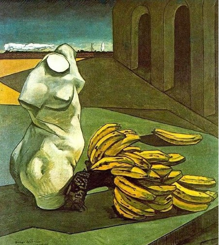 the color photo shows a painting by De Chirico representing a headless bust next to some bananas