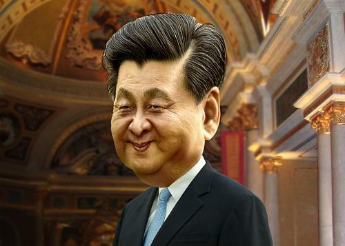 la foto a colori mostra una caricatura di Xi Jinping che sorride. Indossa una cravatta celeste, una camicia bianca e una giacca nera.
